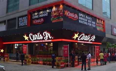 carl s american burger chain carl s jr opens its first