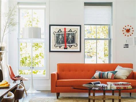 living room with orange sofa living room with an orange sofa daily decor