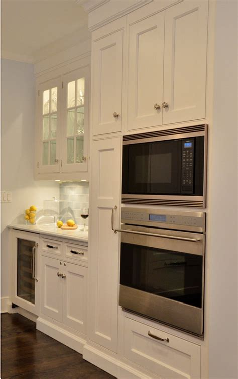 microwave mounted under small cabinet next to fridge decorated mantel room of the week traditional kitchen