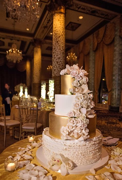White Gold Wedding by White Gold And Blush Four Tier Wedding Cake With Cascading