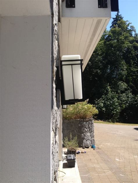 home lighting design 101 fixing a crooked light fixture on a stone wall how to
