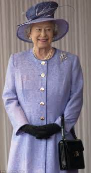 queen elizabeth purse signals how much the queen s handbag collection is really worth