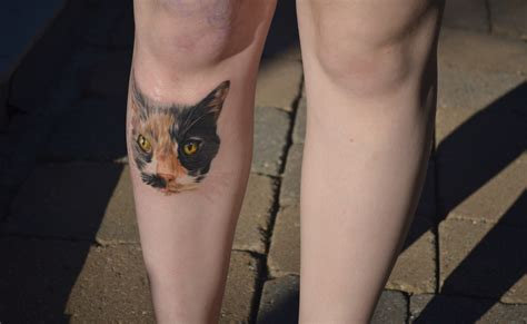cat face tattoo 301 moved permanently