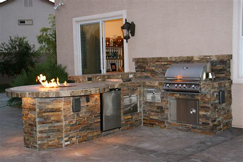 custom outdoor kitchen design  social area  fire