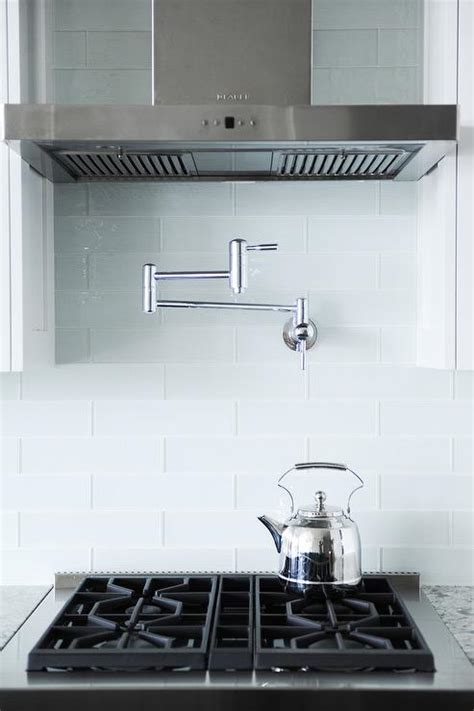 kitchens pot filler tumbled linear stone tiles interior design inspiration photos by twenty one two