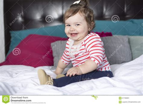 bed for one year old one year old girl in bed stock photo image 61769991