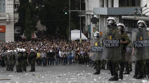 in pictures protests turn violent as angela merkel