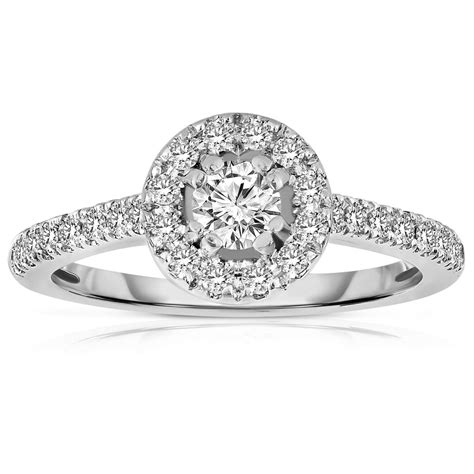 half carat cut halo engagement ring in white