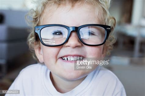toddler wearing his dads reading glasses stock photo