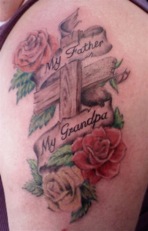 tattoos of crosses and roses flowers and cross with banner on half sleeve