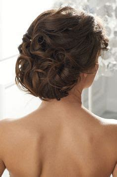 brunette bride hairstyles brunette updo with flowers google search wedding