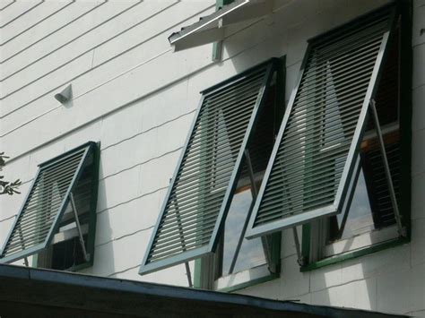 awnings and shutters hurricane shutters storm shutters bahama storm shutters
