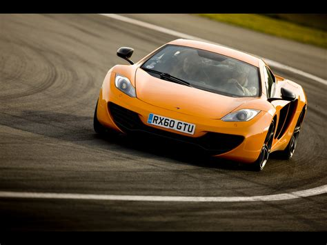 orange mclaren 12c 2012 mclaren mp4 12c orange front angle speed tilt 4