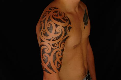 maori tattoo designs arm shane tattoos maori half sleeve on rhys