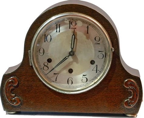 symbolism in the great gatsby mantle clock he had passed visibly through two states and was entering
