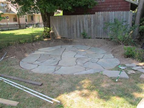 install  flagstone patio  irregular stones
