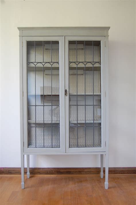 white painted wooden display cabinet   clear glass