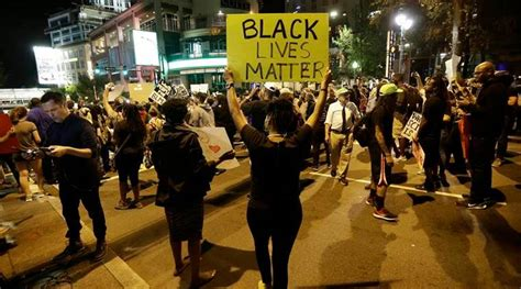 protesters   charlotte   night  stay peaceful  indian express
