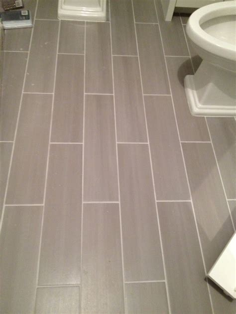 bathroom floor tiles guest bath plank style floor tiles in gray sarah
