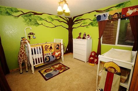 jungle theme baby room nursery with painted tree green