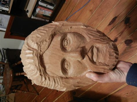 carving  mans face  wood