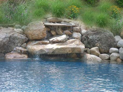 how to build a waterfall into a pool pool landscape design with vanishing edge