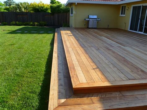 instead of a concrete slab do this low deck with railings