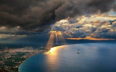 nature landscape sunset sun rays cityscape sea