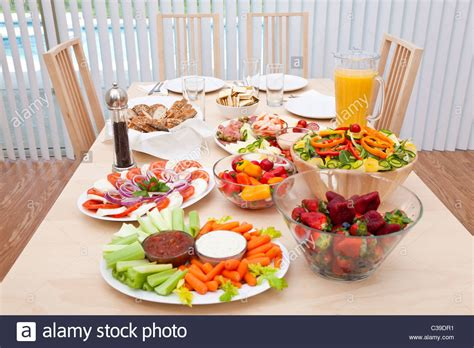 Dining Table With Food Dining Table Laid For A Healthy Lunch Of Fresh Salad Vegetables Stock Photo Royalty Free Image