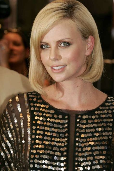 The Look For Less Charlize Therons 2005 Golden Globes Dress by Charlize Theron Turns 40 Then And Now Houston Chronicle