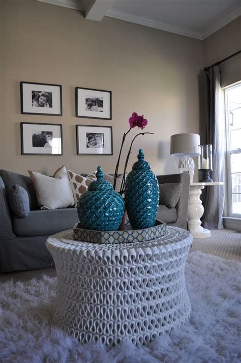 beige and turquoise living room room by jws interiors white rug neutral family room oly studio coffee table turquoise gray