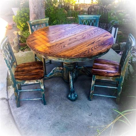 farmhouse pedestal table and chairs sold burnt oak table chair set large distressed