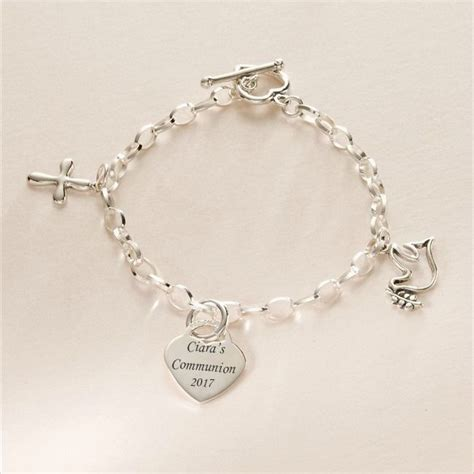 charm uk sterling silver charm bracelet with dove and cross charms