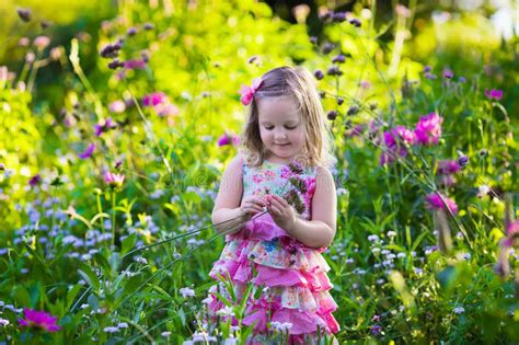 the flower childs play 184643016x little in flower garden stock photo image of little baby 58581482