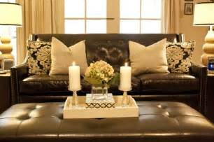 pillows black white damask with brown leather sofa , love the white hydrangea   BROWN SOFA