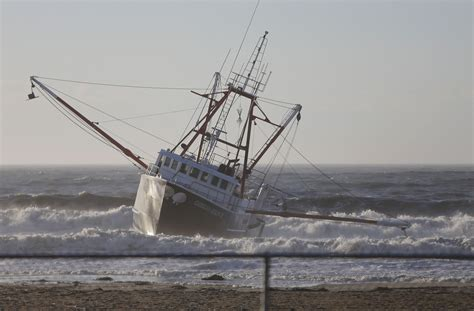 cost of fishing boat coast guard vessel flips over while responding to grounded