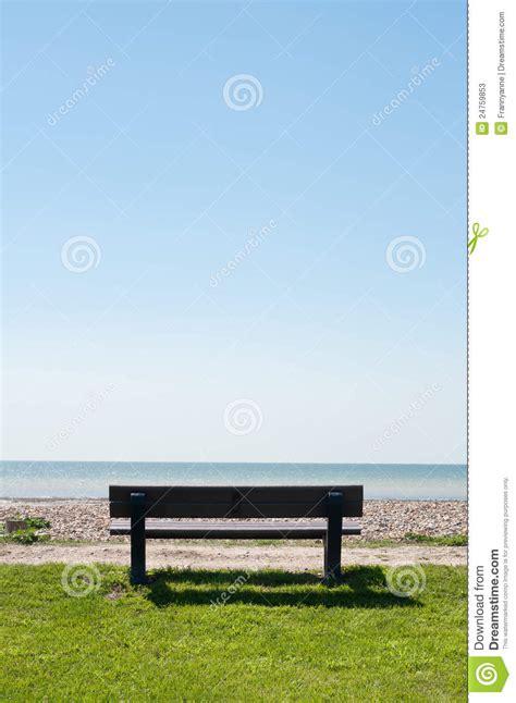empty bench facing sea stock image image  bright