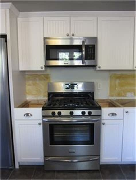 stove opening between cabinets 1000 images about kitchen on pinterest microwaves