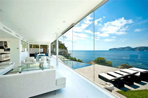 Beautiful Interior Home Designs Would Buying This Glazed Waterfront Designer Villa Make