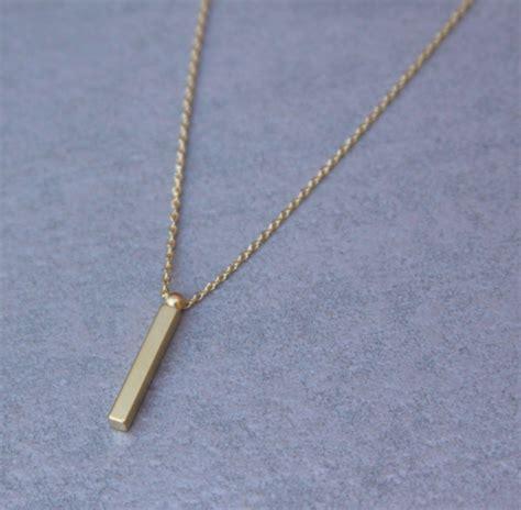 vertical gold bar necklace design by reija burke decor