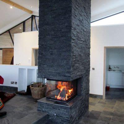 chimney log burner fireplace in middle of open plan room