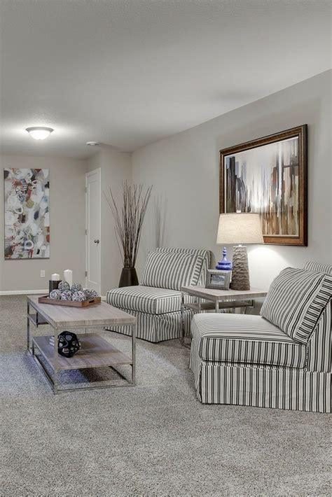 cute seating area  gray carpet gray walls  white