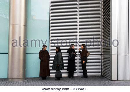 no smoking signs officeworks smokers smoking outside office building in hong kong china