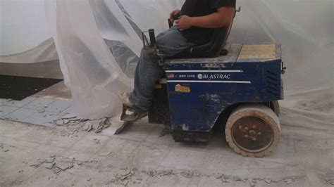 Tile removal using Blastrac floor coving machine