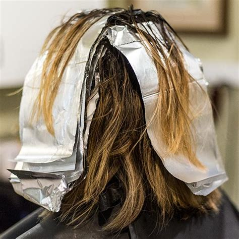 womans haircut foils womans haircut foils woman with coloring foil on her