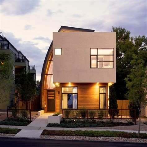 modern home architecture inspiring urban infill with sun catching curve metal