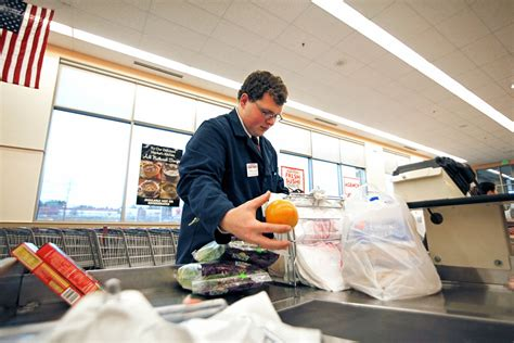 on the travis phillips grocery bagger the portland press herald maine sunday telegram