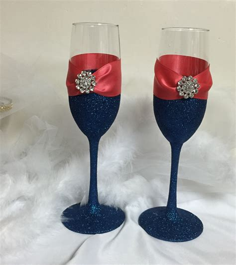navy and coral wedding centerpieces wedding toasting flutes chagne flutes navy blue glitter