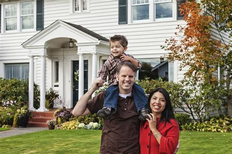 Family In Front Of House by Time Homebuyers 4 Money Mistakes To Avoid