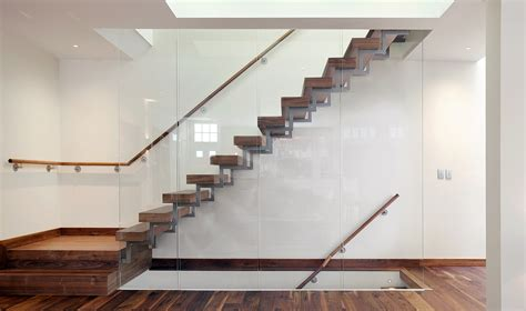 Interior Concrete Stairs Design Interior Concrete Staircase With Wooden Steps And Glass Railing Panels Of Plus Concrete